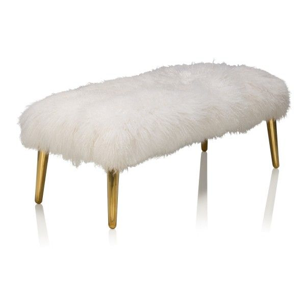 A decadent bench featuring soft and luxurious Mongolian Lamb and polished brass.