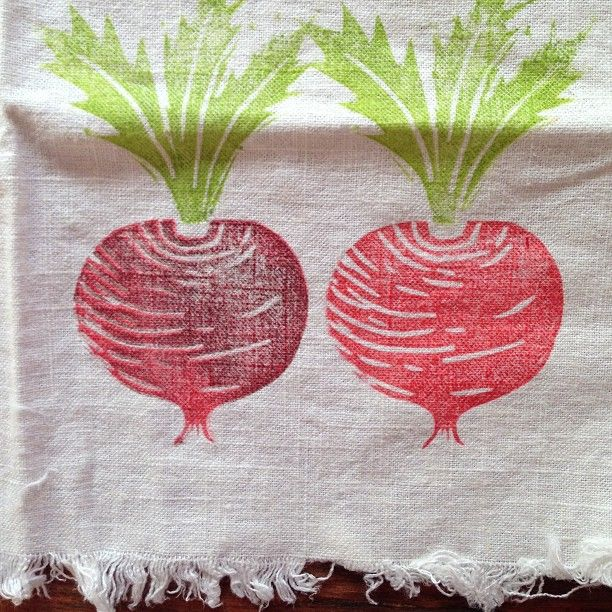 Carved beet stamp on fabric. Stamped left beet twice - once with red, then brown