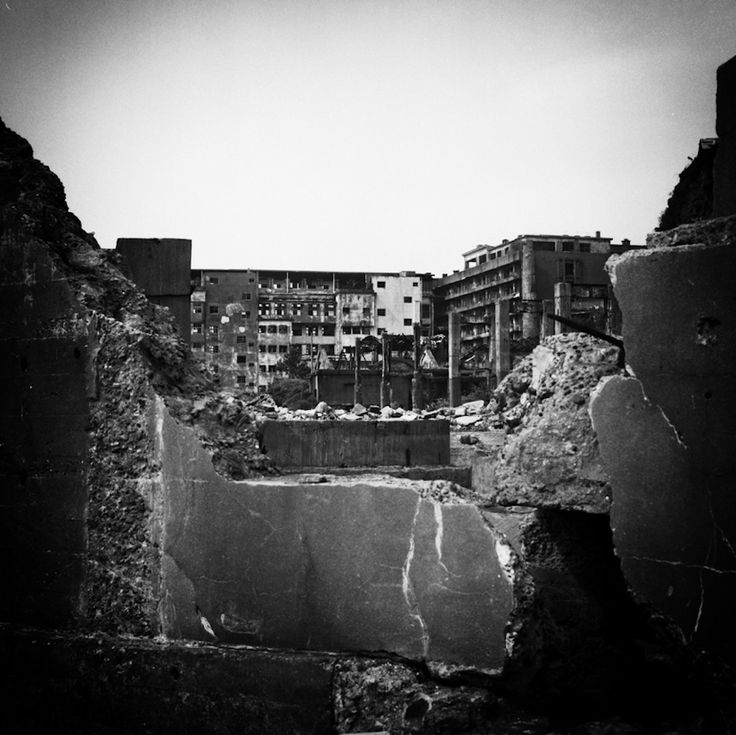 """Beautifully eerie urban decay: """"Hashima Island"""", or """"Gunkanshima"""", was a former coal mining community.  It was established in 1887.  The mine was closed in 1974 and the city subsequently abandoned."""