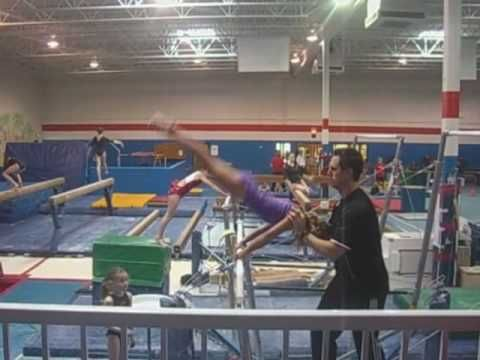Teaching the lean over the bar with spotting for straight body cast to handstand.