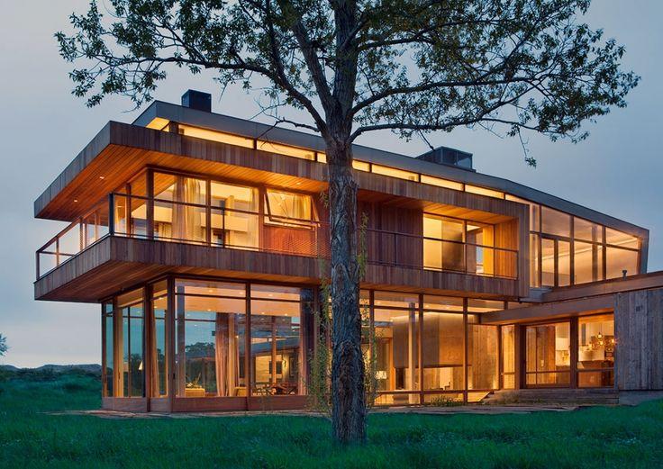 Einfamilienhaus Holz Innendesign Belag viele Fenster
