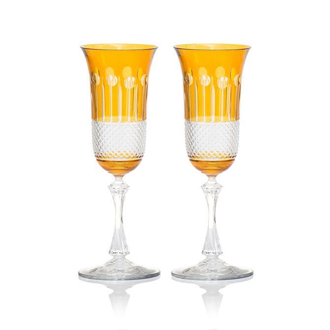 """With a distinct nod to tradition which embraces a modern happiness and vigorous lifestyle, the amber range includes stemware and barware in set of six. The range invites the curation of modern """"friends and family"""" drinking experience, which interplays between proportion, weight and size.  In this chic, colourful style, luxurious is given free rein. Representing handmade, 24% lead crystal, these amber champagne glasses will accessorise both traditional and modern interiors.  Despatched in…"""