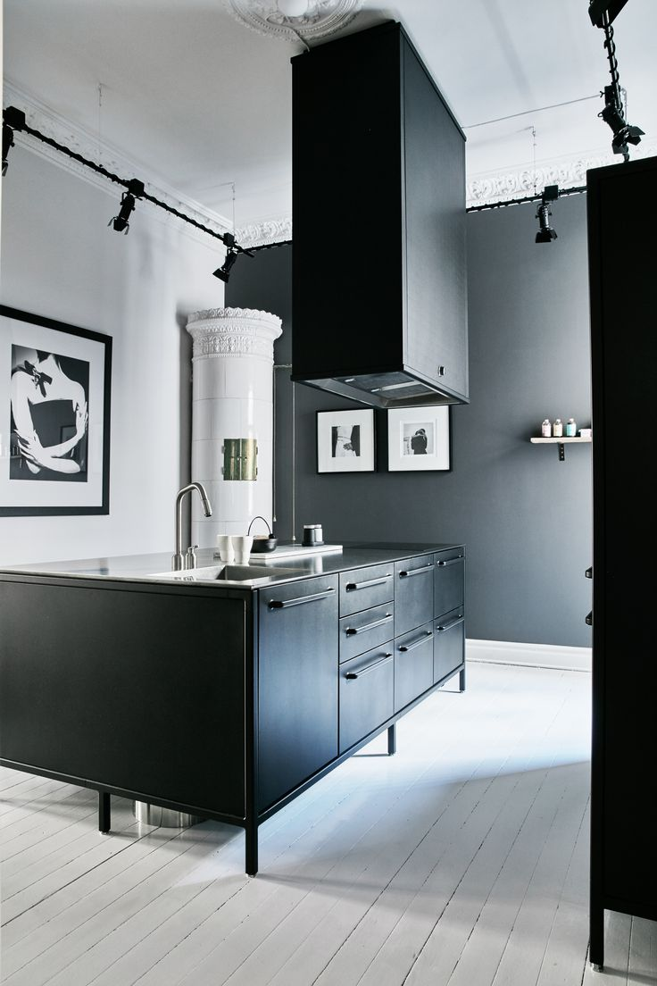 Etienne de souza designer and manufacturer of luxury cabinet - A Black Kitchen Island In Steel With A 4 Mm Table Top In Stanless Steel