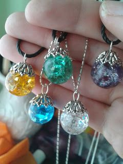 Just put your marbles in the oven for about 20 minutes at 350 degrees. As soon as you take them out submerge them into ice cold water and that is how they get the cracked look. Just glue the bead cap of your choice and add your favorite chain.