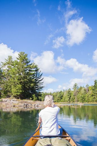 A wooden cabin in the woods, canoeing on a crystal clear lake and backcountry…