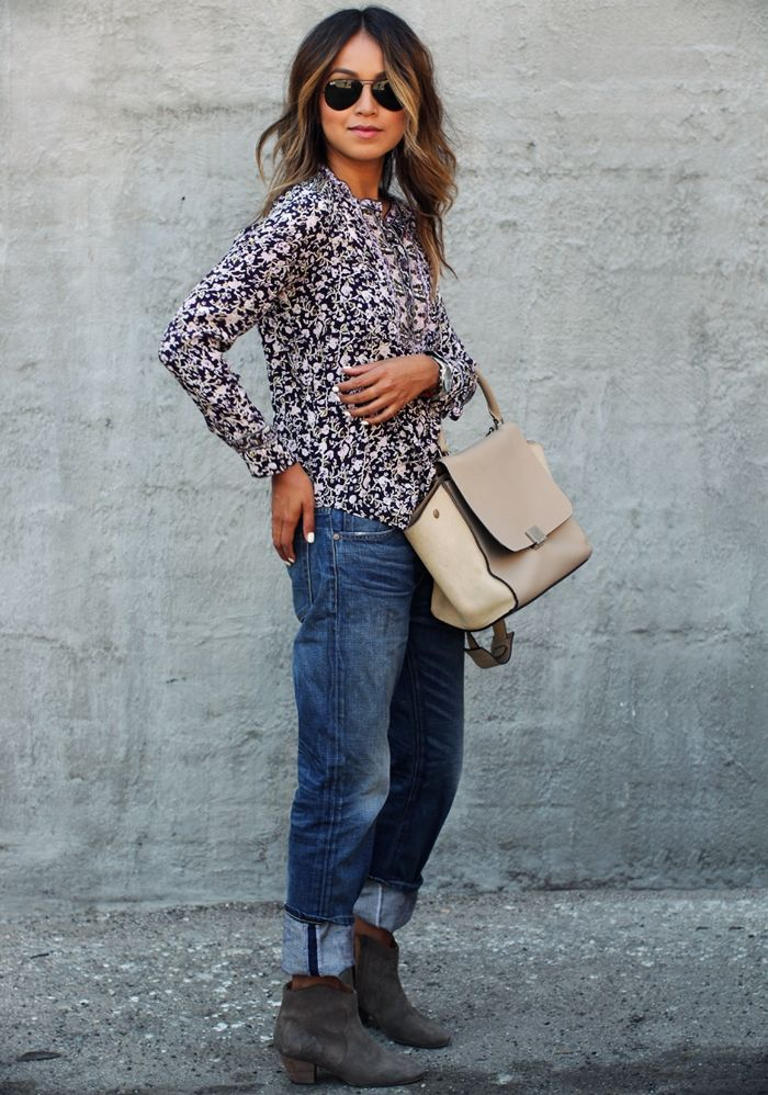 Julie Sarinana is wearing a top from Rebecca Taylor, sunglasses from Rayban, Jeans from  NSF and Boots from Isabel Marant