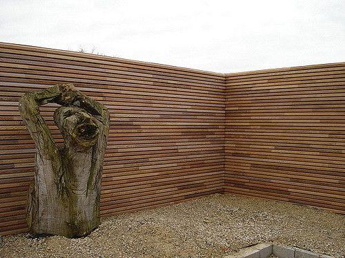 Zicht op de tuin - Het profiel werd eveneens gebruikt als tuinafscherming Realisatie : Woningbouw Dumortier