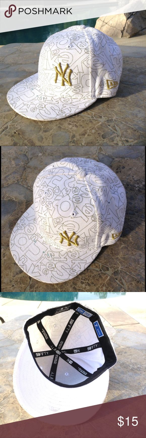 New Era Yankee Cap White and gold New Era Yankee cap. Size 7 True Fit 59 Fifty. Not even broken in. Clean with small marks on bill. Not noticeable. May come off! New Era Accessories Hats