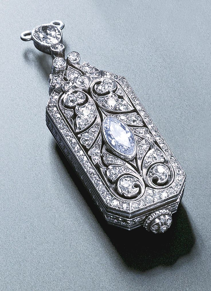 A LADY'S PLATINUM AND DIAMOND-SET PENDANT WATCH, RETAILED BY TIFFANY & CO. CIRCA 1910.