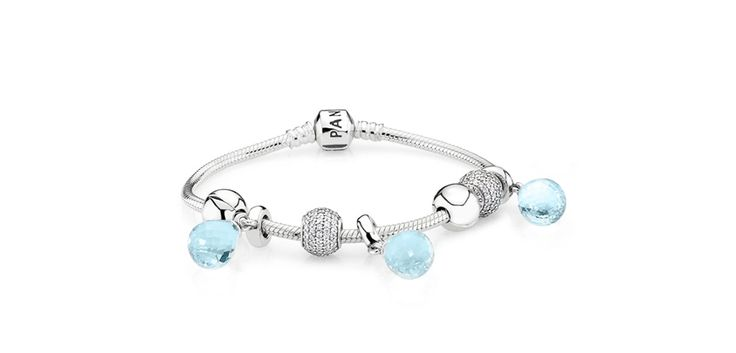 Like a droplet of water, frozen in the cold winter weather, the sculpted blue glass is suspended from a sterling silver loop. #PANDORA #PANDORAbracelet #ChristmasCollection