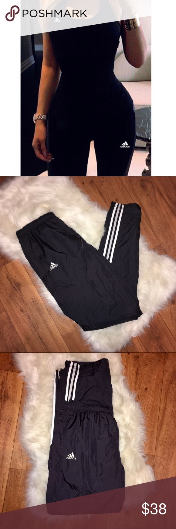 ⚡️Adidas Superstar Windbreaker Track Pants ⚡️Adidas Superstar Athletic Track Pants  - Black with white racing stripes down sides of the calves. Vintage 90's style.  Logo on front - Size Large- Windbreaker material - Athletic track pants, super comfortable  - loose, slouchy fit, strait legs, full length, zippers on the side of lower legs for looser fit. Lined with mesh inside. Gr at condition purchased from PACSUN TAGS: #pacsun #athletic #90s #gym adidas Pants Track Pants & Joggers