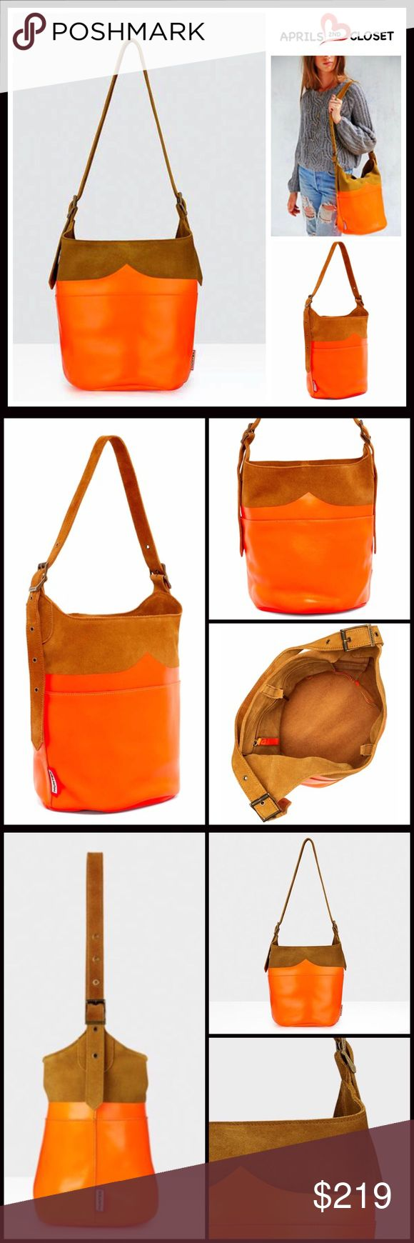"""HUNTER Original Suede Leather Bucket Bag 💟NEW WITH TAGS💟  HUNTER Original Suede Leather Bucket Bag  * Exterior features tonal color-block leather / suede construction   * Single adjustable shoulder handle; 9"""" - 11"""" drop; Interior hanging zip pocket  * Lobster clasp top closure  * Approx. 12.5""""H x 15""""W x 9 3/8"""" D  * Hunter logo detail; Dustbag included  * A firm structure bottom Material- Suede Color-Neon orange, tan  🚫No Trades🚫 ✅ Offers Considered*/Bundle Discounts✅ *Please use the…"""