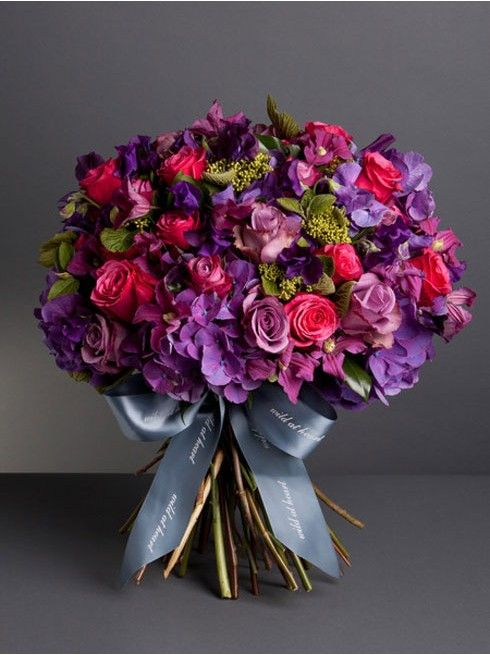 Wild At Heart - LIBERTY BOUQUET  - A stunning selection of seasonal flowers inspired by our Nikki Tibbles Wild at Heart Liberty store in the famous Liberty purple, combining purple hydrangea, blue curiosa roses, hot pink cheerio roses, purple clematis and flowering eucalyptus. Picture showcases our large bouquet.