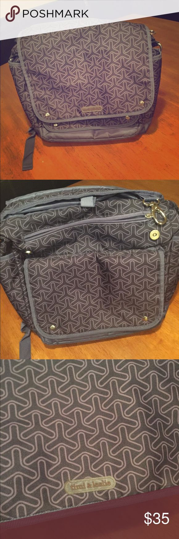 Timi & Leslie diaper bag/backpack. Patterned Timi & Leslie diaper bag that also has straps to carry it on your back. Lots of pockets. Key fob. Easy to clean. One zipper is missing its pull. Great used condition. Timi & Leslie Bags Baby Bags