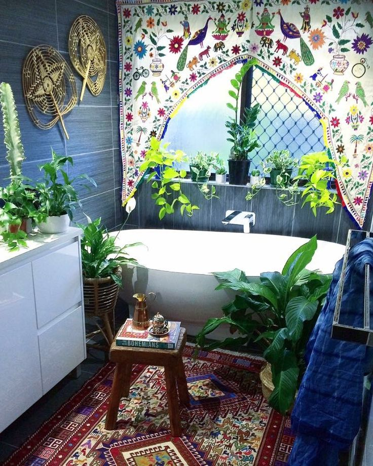 Boho by the sea . cute bohemian bathroom. Love the embroidered window curtain valance. with lots of plants!