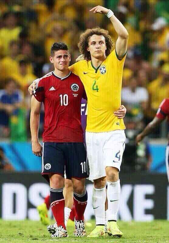Picture of the day ( David Luiz consoles World Cup highest goal scorer James Rodrigues as Brazil defeats Columbia)