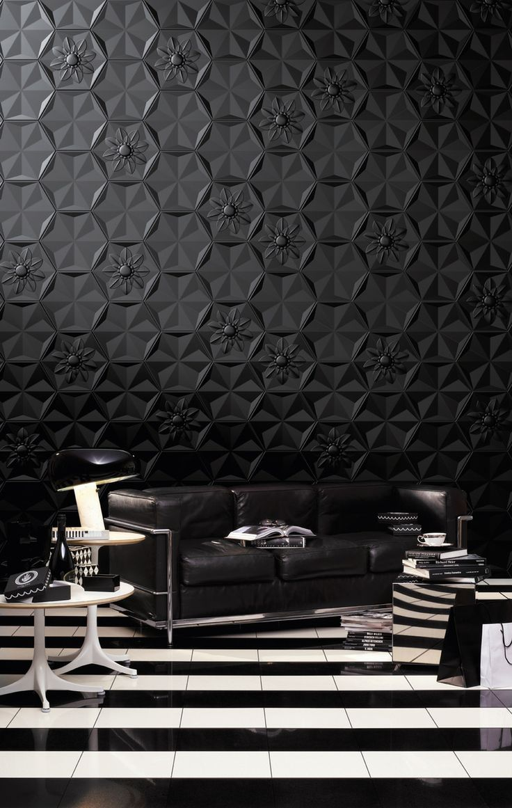 Get creative if you want a black and white room. Play with different textures like this gorgeous room. We LOVE the wallpaper.