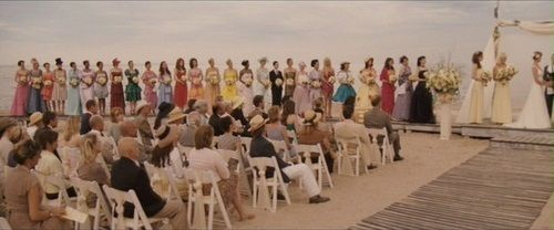 Here are the 27 bridesmaids dresses, worn by the 27 brides. Also two bridesmaids in the bridesmaids dresses chosen by the main character. Also; the bride.