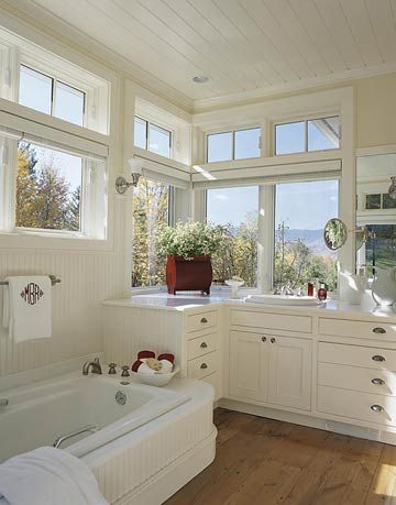 Reclaimed Wood Floor- but I actually love the cabinets and tub surround better than the floor!