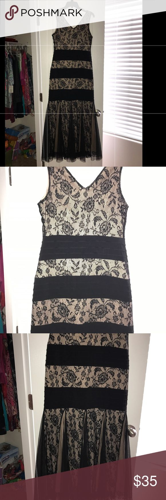 Beautiful dress Very nice nude with black lace sexy mermaid dress stretchy and fits like a glove size SP like new wore only one dry cleaned Dresses Maxi