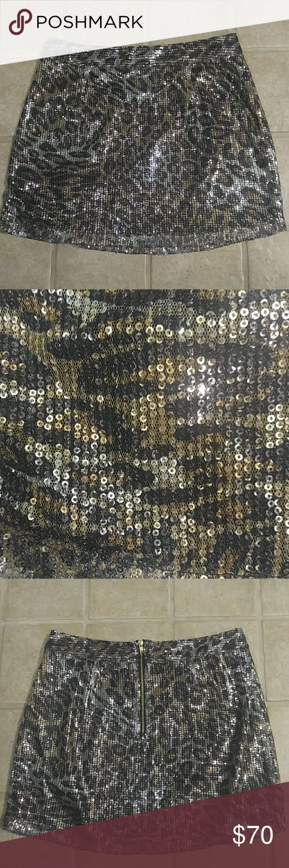 NWOT Sequin Leopard Mini Skirt Brand new, never worn. Shimmer gold/black/silver leopard print sequin mini skirt. Back zipper, fully lined. Purchased in mid 2000s. Moon Collection Skirts Mini