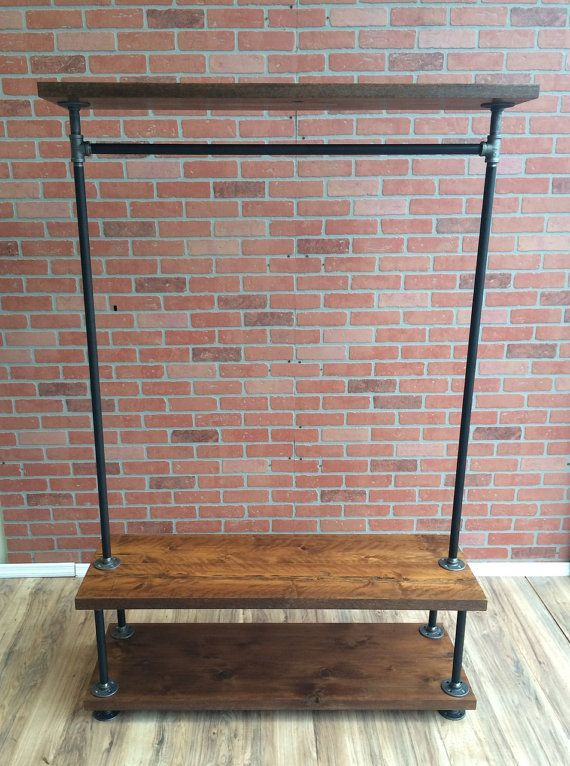 """Industrial Pipe Clothing Rack with Cedar Wood Shelving by William Roberts Vintage  This Industrial Style Vintage Clothing Rack is made to last forever. Using 3/4 black pipe and 3/4 Iron pipe fittings, this heavy duty clothing rack is finished with Rustic Cedar Wood. Our clothing racks are great for use in retail stores or for extra storage in your home.  Features: •¾"""" Black Pipe and Fittings •Rustic Cedar Wood •Heavy Duty Design •Industrial Vintage Look •Made in the USA with Global ..."""