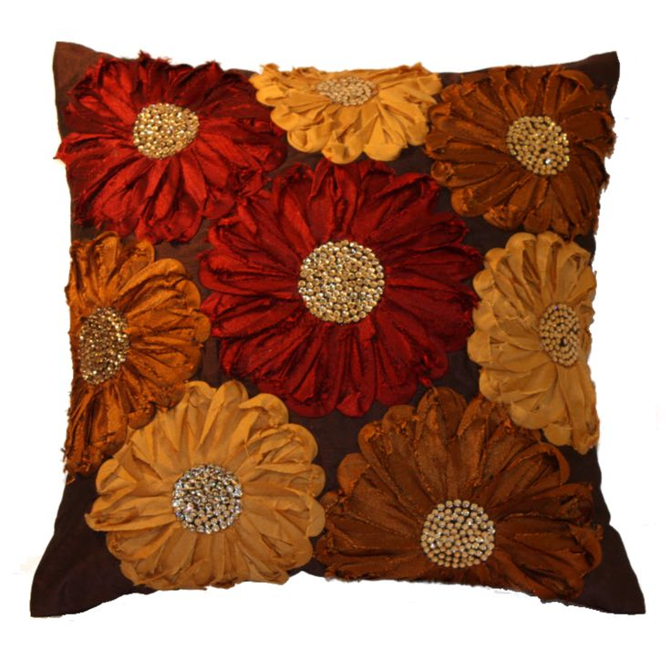This piece of cushion cover will definitely give your living area an elegant touch because of its unique assembling of Flowers in attractive 3D effect. It has floral patches on brown base in different colours . The fine quality stones used in the flowers make it even more beautiful and charming and thus promises to give your living area a sophisticated touch. FEATURES : 16 Inch * 16 Inch / 40.5 cm *  40.5 cm