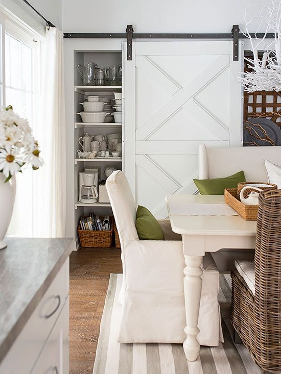 Doors chomp up square footage opening and closing -- but they're necessary to screen views from one room or another or hide storage. A sliding barn door -- used here to disguise adjacent dining and kitchen storage -- offers a pretty solution. Doors such as this roll on simple-to-install hardware; choose one with details that pick up on accents already in the room, or paint yours a contrasting color for a pop./