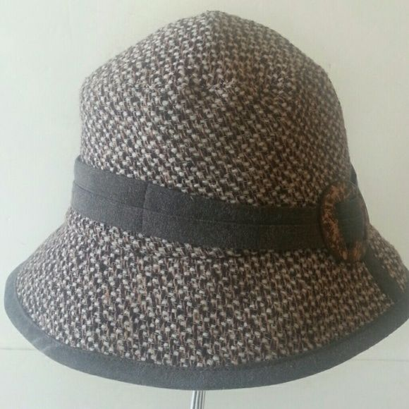 SALE!  Tweed Bucket Light weight tweed fabric in the earth tones of brown, camel, and cream. Trimmed in a cotton band of brown finished with a two tone tortoise shell bracket. The brim is also trimmed in the same fabric as the band insert is a wire to bend the brim as you please. Fully lined in chocolate satin. Great travel hat. Limited Edition redfish Accessories