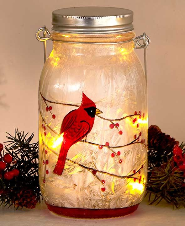 """Embrace the beauty of the winter season with these Frosted Glass LED Jars. This jar is the perfect addition to your holiday decor. Five inner LED lights on a string (27""""L) illuminate the frosted finis"""
