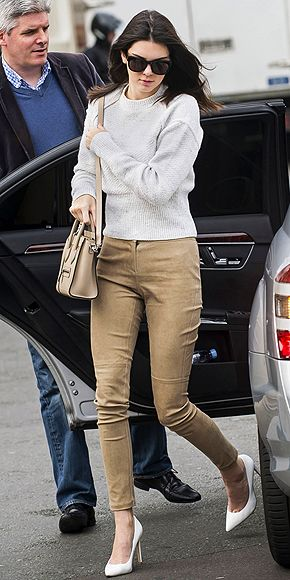 Head-to-toe neutral tones can be super-snoozy, unless you take a cue from Kendall. She plays with texture to make her outfit pop, balancing her ribbed beige sweater with tan suede Theory pants, then keeps her accessories sleek (and lust worthy) with a mini bag and pointed white pumps.