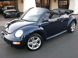 2005 VW Beetle Convertible Turbo. Just like Gabby except shes gunmetal gray