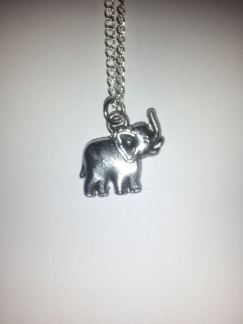 A beautiful Elephant on a 20 Inch Silver Chain!    Holding it's trunk high, the Mighty elephant is a good luck charm!    Homemade!