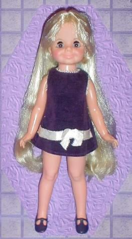 Ideal Crissy Doll's Cousin Velvet.  I had this doll and adored her purple dress and lovely lavender eyes!