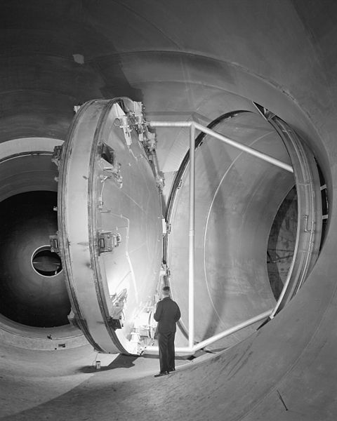 24 foot diameter swinging valve at various stages of opening and closing in the 10ft x 10ft Supersonic Wind Tunnel, 17 May 1956, public domain via Wikimedia Commons.