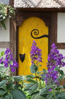 Yellow Door.... And purple flowers on the steps