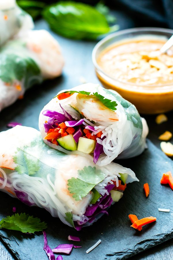 Vietnamese Fresh Spring Rolls are full of basil, cilantro, shrimp and veggies and then paired with a slightly spicy peanut sauce.