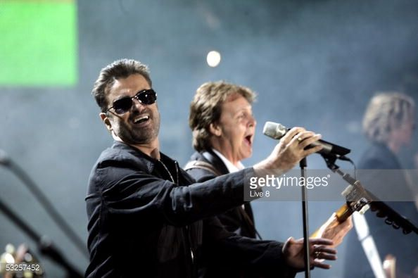George Michael and Paul McCartney perform on stage for the finale at 'Live 8 London' in Hyde Park on July 2 2005 in London England The free concert...