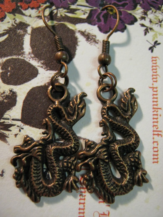 Copper Dragon earrings on french wires.. $7.99, via Etsy.
