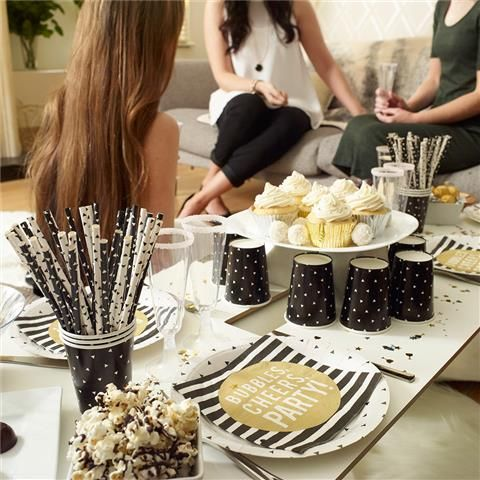 Shimmer Party Solution  Includes: 1 x Tablecover - Black Triangle 1 x Silver Plastic Forks - 12 pack 1 x Silver Plastic Knives - 12 pack 1 x Paper Plates - Black Triangle, 16 pack 1 x Paper Straws - Black Triangle, 24 pack 1 x Paper Cups - Black Triangle, 24 pack 1 x Shimmer Napkins - 20 pack 1 x Circle Garland - Black, Silver and Gold 1 x Pom Pom Balls - Black and White Mix, 3 Pack 1 x Plastic Champagne Glasses - 6 pack