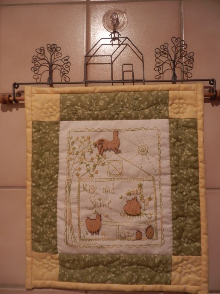 Lynette Anderson stitchery and buttons made in to this little quilt!