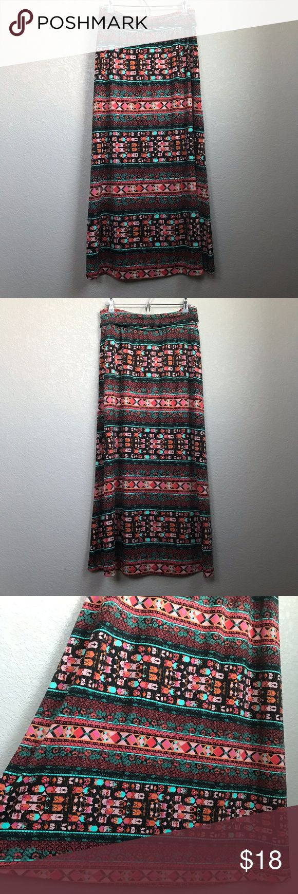 "Mossimo Long Stretch Maxi Skirt Aztec Print Medium Mossimo Supply Co long, aztec maxi skirt. Multi-color, multi-pattern. Stretch. Geometric. Boho. Size medium.  Excellent pre-owned condition!  Total length: 37""  Waist measured flat straight across: 15 1/2""  [V] Mossimo Supply Co. Skirts Maxi"