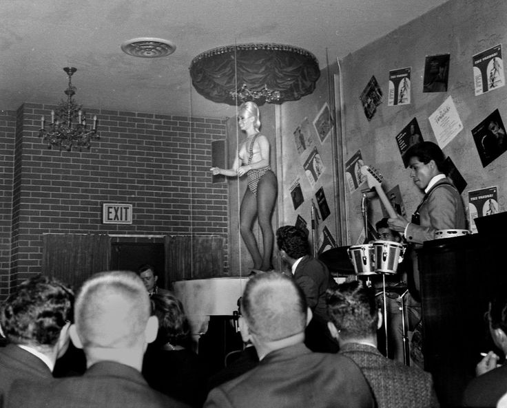 Carol Doda, in a topless swimsuit  dancing at the Condor Club, San Francisco, June 23, 1964. The photograph was taken before Doda's breast were enhanced by silicone injections. Photo: Gordon Peters, STAFF