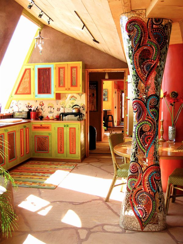 Inside SOLARIA - Solaria Earthship, Taos, New Mexico (I would like to crochet a rug in similar colors and pattern)