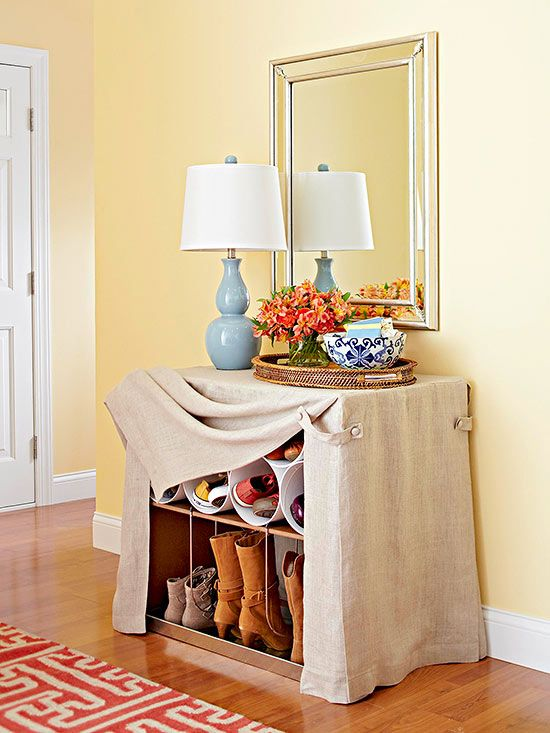 It looks like a linen-skirted table awaiting the mail and other just-in-the-door deliveries, but those flax-hued drapes conceal ingenious storage for shoes and boots: http://www.bhg.com/rooms/rooms/entryway/front-entry-decor-ideas/?socsrc=bhgpin051414undercovers&page=10