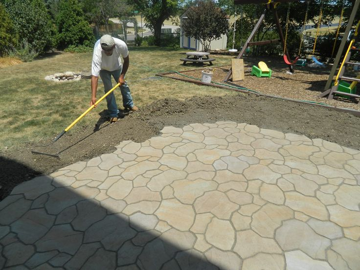 flagstone patio on concrete not the normal square pattern but lots of different shapes making - Different Patio Ideas