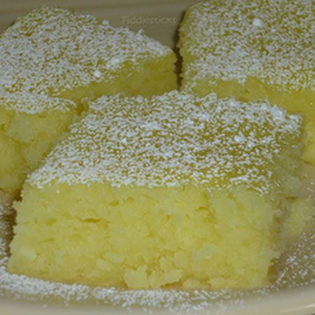 Mix one box angel food cake mix with 42oz of canned lemon pie filling, bake at 350° for 25min, cool, sprinkle with powdered sugar.