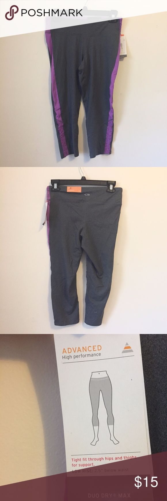 NWT Champion Grey & Purple Workout Capris Medium Champion workout capri leggings - grey with purple panels on sides. Ruching on legs near bottom hem and on hips. New with tags. Size medium. Champion Pants Leggings
