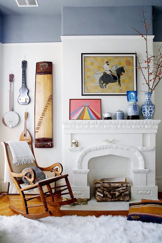 Give the impression of dramatic crown molding with a painted ceiling that extends about a foot down the wall. In the San Francisco home of Windy Chien as seen on sfgirlbybay, the paint calls attention to the picture rail molding below.