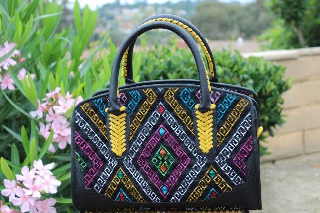 Super adorable!!  Handbag with Indonesian handmade Weaving Fabric and premium cow leather. Made in Indonesia.